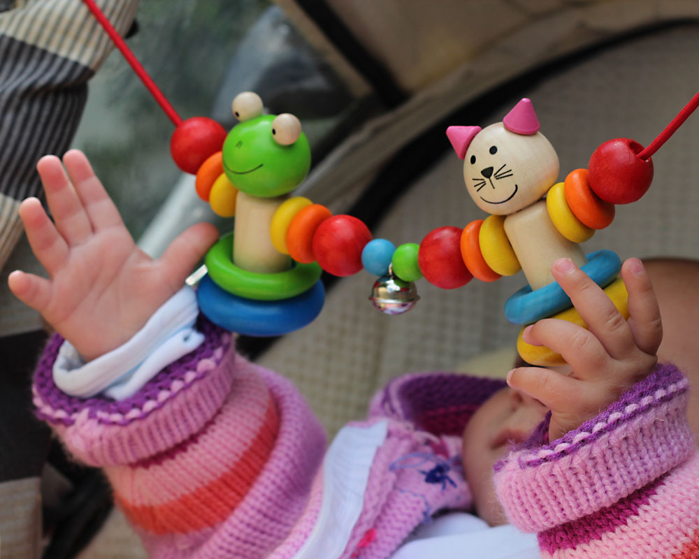 Baby with amici wooden toy by selecta
