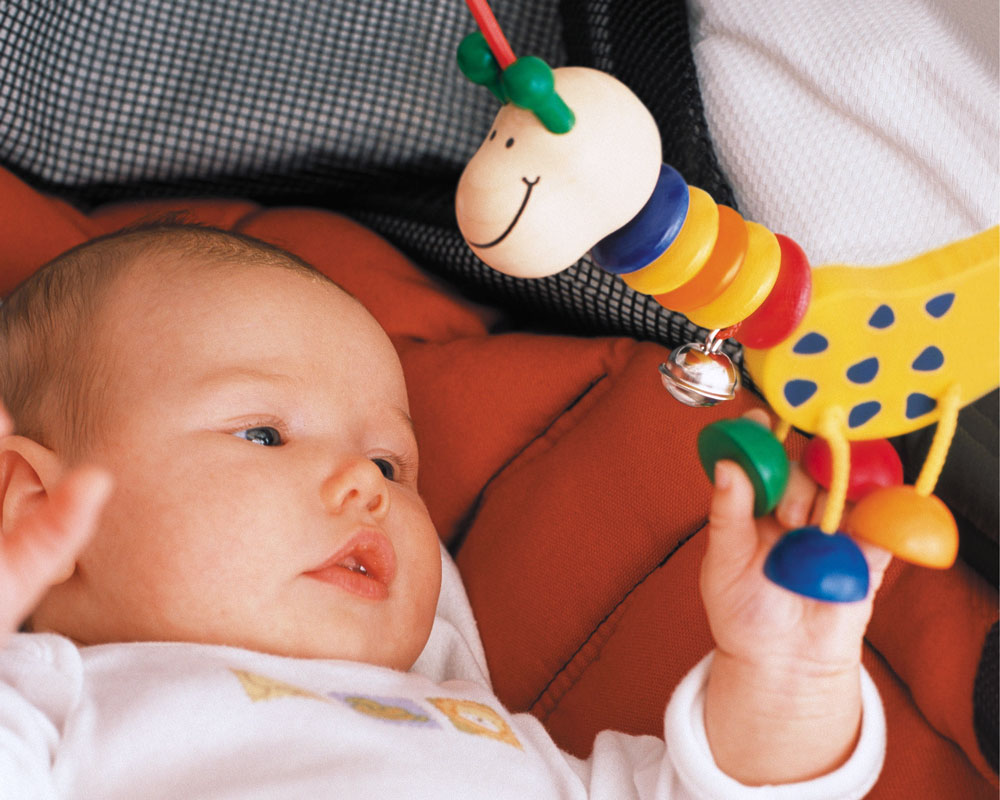 Baby with collina wooden toy by Selecta