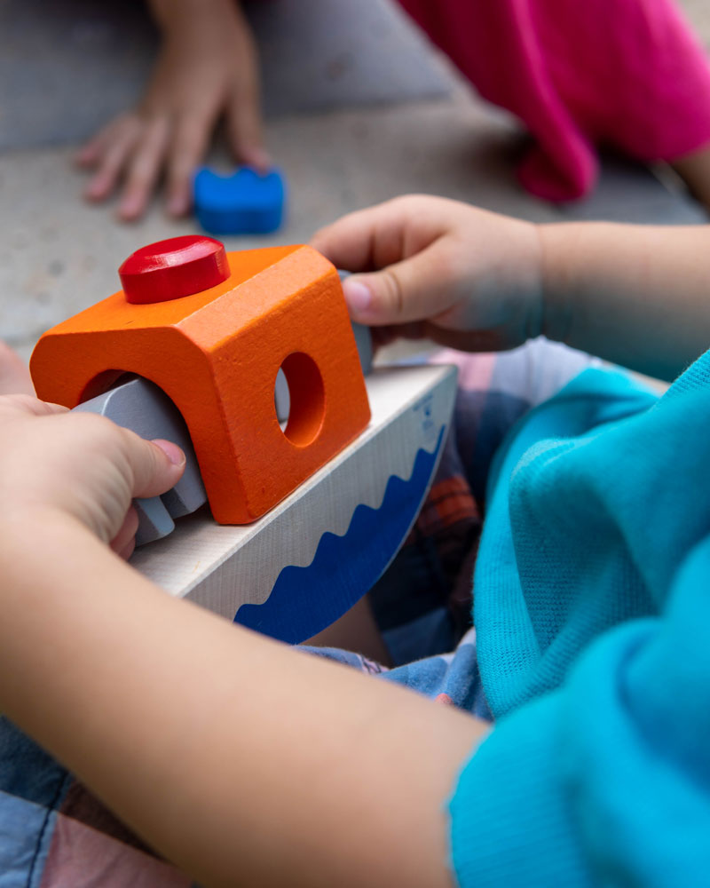 Baby with wippofant wooden toy by Selecta