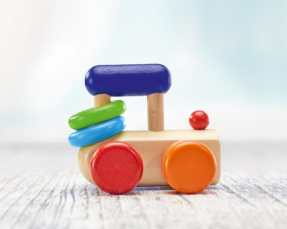wooden roller grabbing toy locomotive